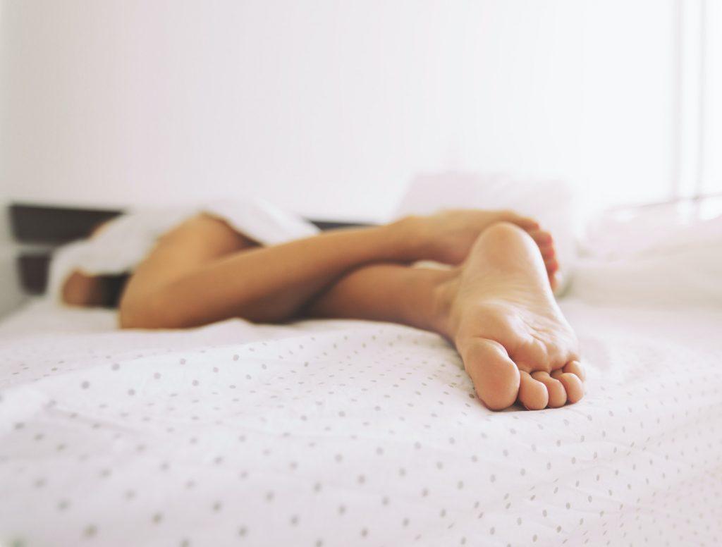 Feet of a sleeping woman